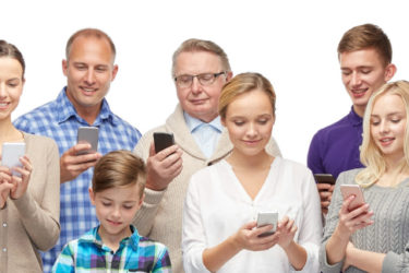family, technology, generation and people concept - group of smiling men, women and boy with smartphones