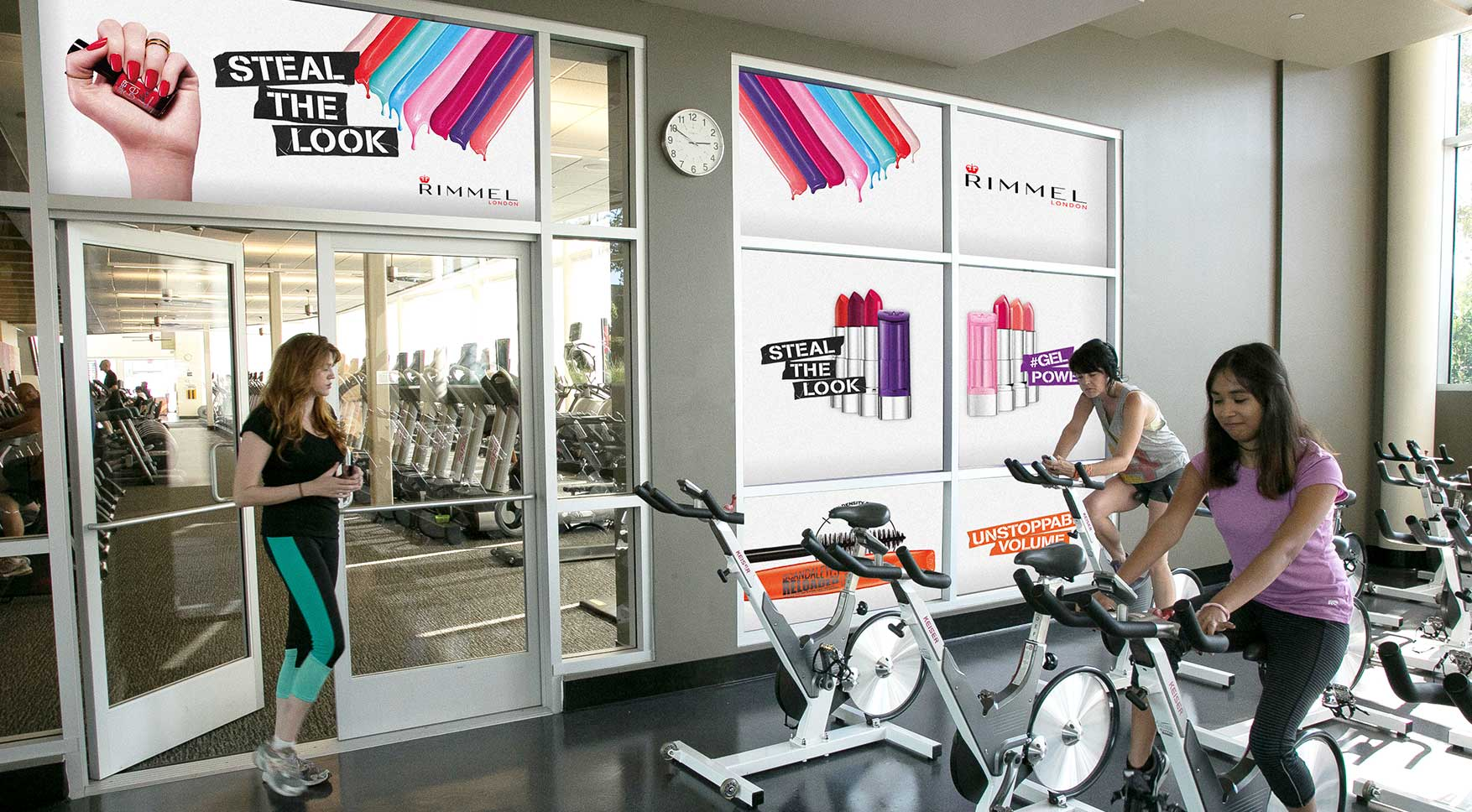 Women in exercise clothes in spin class near Gym Advertising