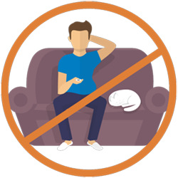 Man in slippers and t-shirt sitting on couch with his cat holding a tv remote